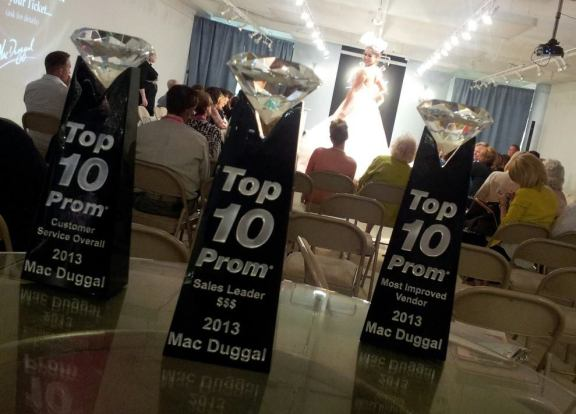 Best of the Best ~ Mac Duggal's three Top 10 Prom awards were placed on prominent display during the Atlanta Prom Market fashion runway show from Aug. 8-11, where the fabulous Spring 2014 line was revealed to retailers!