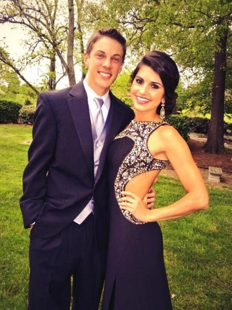Hannah Hausman Wearing a Beautiful Mac Duggal Dress with Her Date